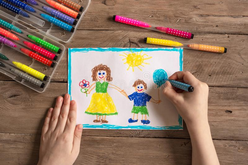 Incomplete family drawing. Children`s drawing of family single mom and son. Incomplete family concept royalty free stock photography