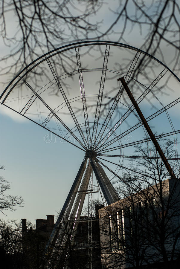 Incomplete Ferris wheel. Large Ferris wheel under construction in a city centre venue stock photography