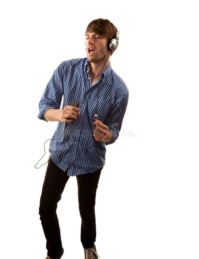 Inconformista alto con los auriculares fotografía de archivo libre de regalías