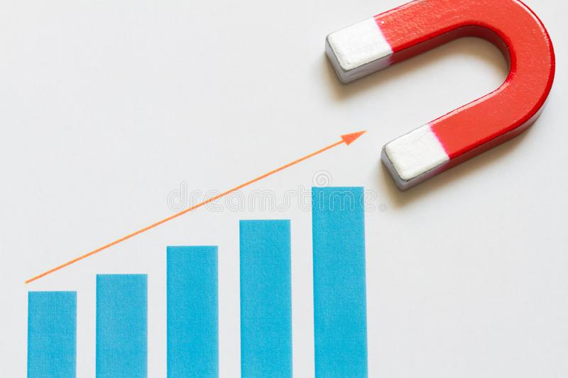 Increase business money with chart and magnet abstract. Background royalty free stock photos