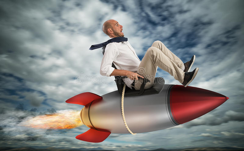 Increase the climb to success. Businessman flying over a rocket in the sky. Increase the climb to success concept royalty free stock photo