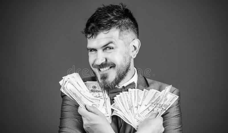 Increasing his cash income. Currency broker with bundle of money. Rich businessman with us dollars banknotes. Bearded. Man holding cash money. Making money with royalty free stock image