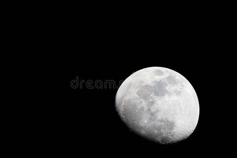 The increasing moon in a black sky stock photo