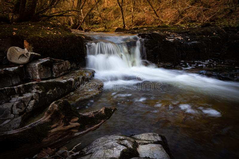 Incredible long exposure of a waterfall in Brecon Beacons National Park at sunset in Wales, UK stock image