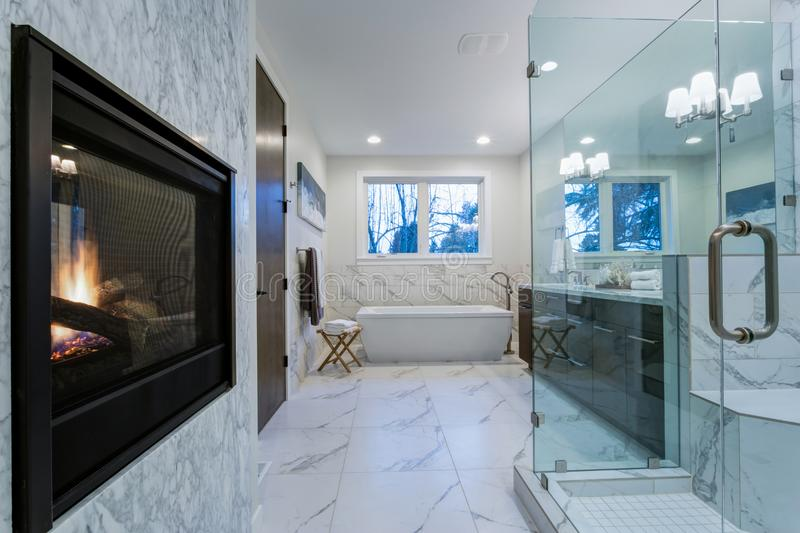 Incredible marble bathroom with fireplace. royalty free stock photos
