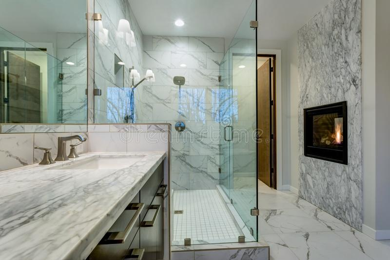 Incredible marble bathroom with fireplace. royalty free stock photography