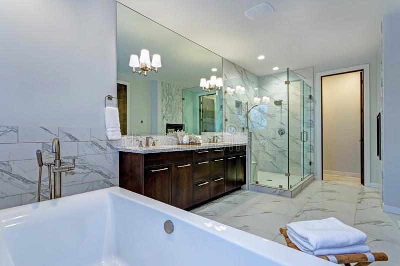 Incredible marble bathroom with fireplace. stock photo