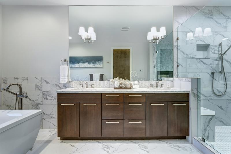 Incredible master bathroom with Carrara marble tile surround. stock image