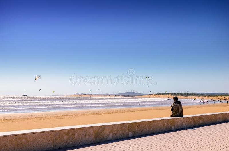 Incredible Morocco, amazing Essaouira, a beach with people engaged in Kite Surfing stock photos