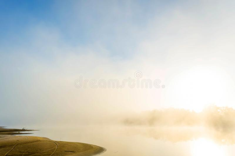 Incredible mystical fog and mist over the river in the early morning at dawn while fishing. Belarusian esie. Pripyat royalty free stock photo