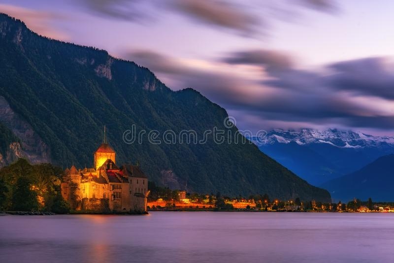 Incredible night scene with Chateau Chillon illuminated in twilight, Geneva Lake, Montreux, canton of Vaud, Switzerland. Incredible night scene with Chateau royalty free stock photography