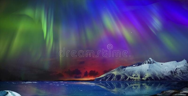 Incredible northern lights. Gorgeous, unreal beautiful night view of the reflection of the northern lights in the water of the ocean and snow-capped mountains royalty free stock image