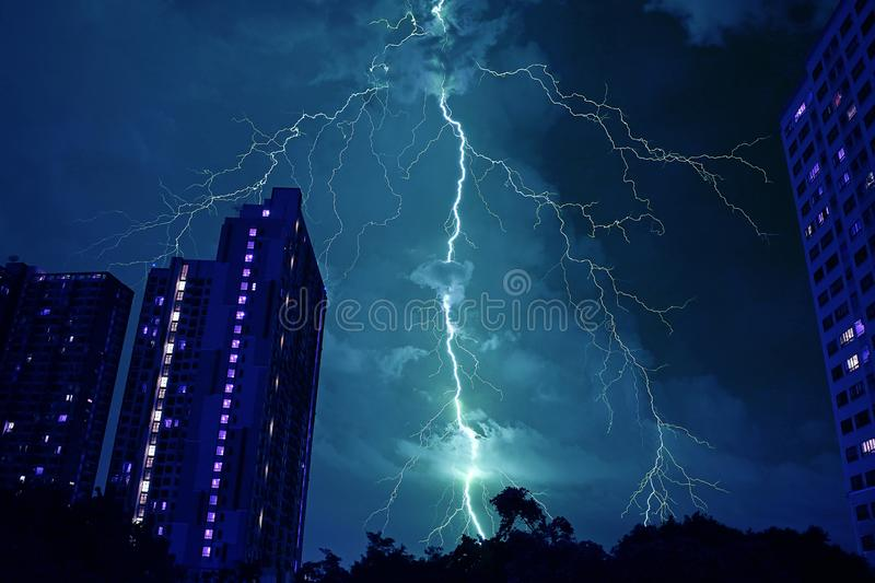 Incredible Real Lightning Striking the Night Sky in Mystique Blue Color royalty free stock image