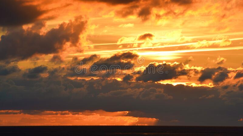 Incredible Sunset behind the Clouds stock photos