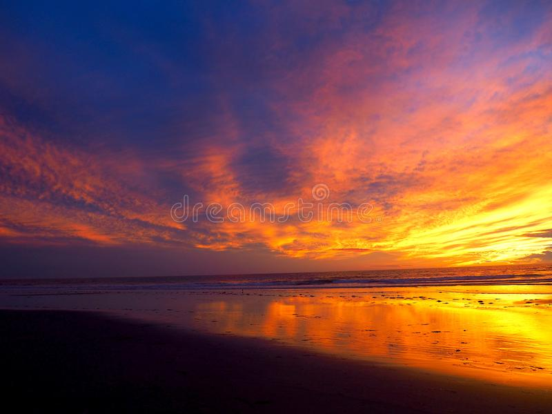 Incredible Sunset on the Pacific Ocean in Southern California. A stunning sunset with vibrant neon colors: pinks, purples, blues, and oranges taken at Grandview stock images