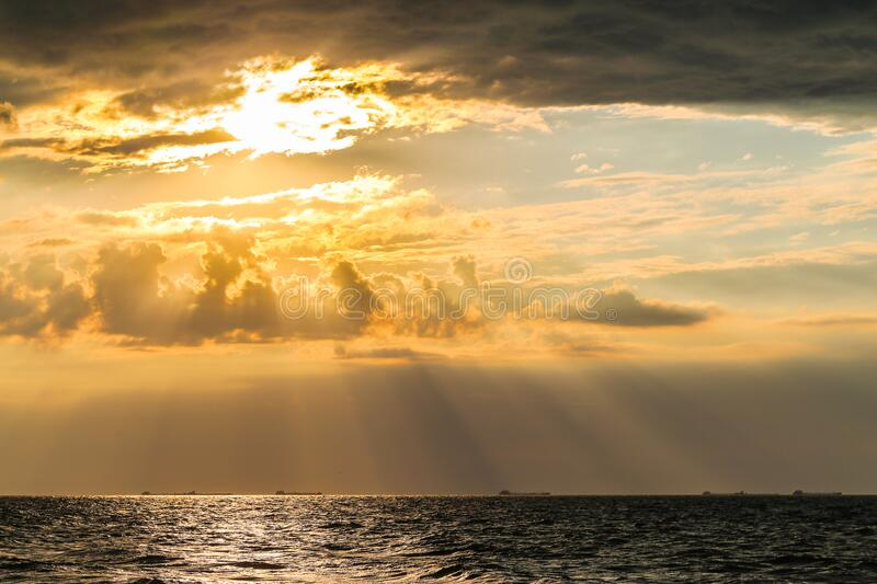 Incredible sunset in the sea. With clouds stock image
