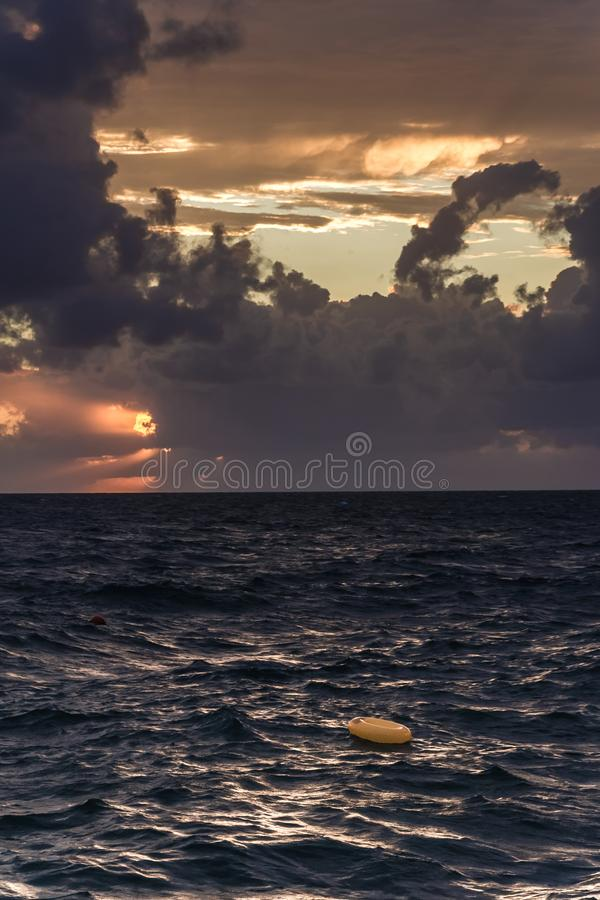 Incredible sunsets on the black sea. Clouds over sea. A splash of water. Waves. Sunset at sea. The road through horizon. pier in sea stock photography