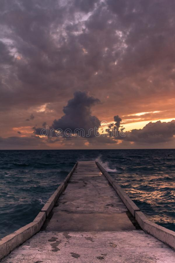 Incredible sunsets on the black sea. Clouds over sea. A splash of water. Waves. Sunset at sea. The road through horizon. pier in sea royalty free stock photos