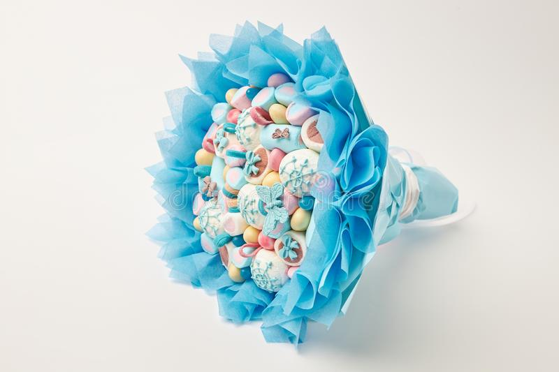 Incredibly beautiful bouquet of multi-colored marshmallows, sweets, decorated with chocolate on a white background royalty free stock photography