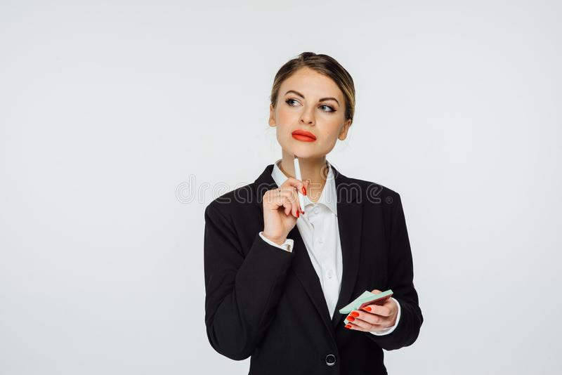 Incredibly beautiful business woman comes up with a creative idea for her business. An incredibly beautiful business woman comes up with a creative idea for her royalty free stock image