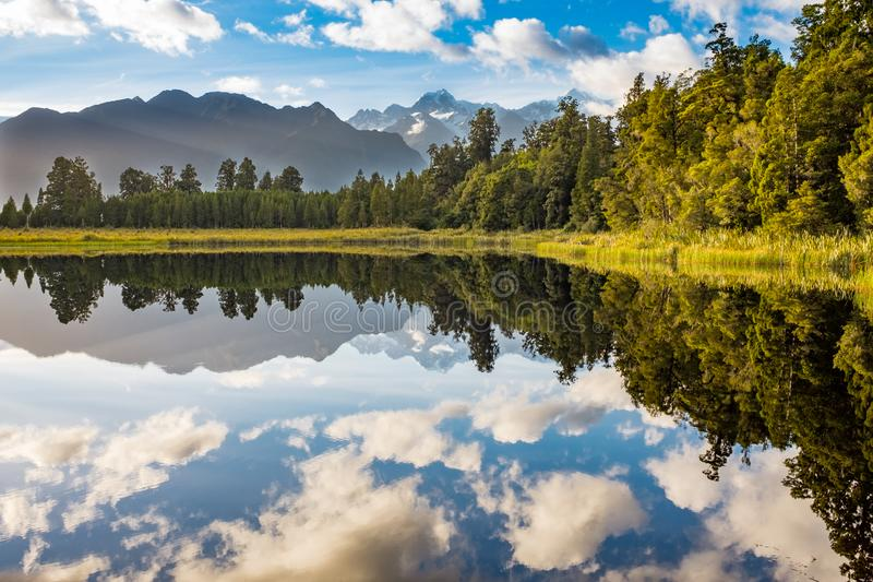 The incredibly beautiful Lake Matheson, New Zealand with the reflection of the stunning Southern Alps. And the majestic Mt Cook in the still waters stock image