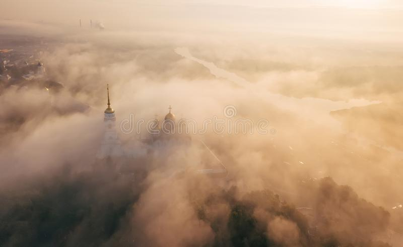 An incredibly beautiful misty morning over Vladimir. Aerial view on Assumption Cathedral in the fog. Russia. Vladimir.  stock photography