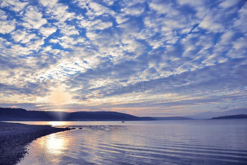 Beautiful sunset.Sun, lake.Sunset, sunrise landscape,panorama of beautiful nature. Blue Sky,amazing colorful clouds.Background. stock photography