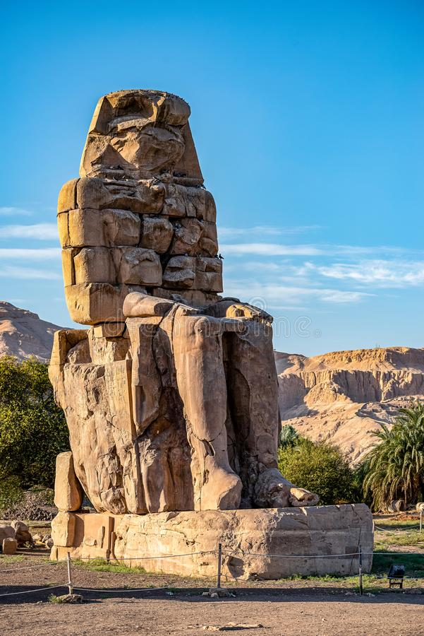 Incredibly magnificent and ancient statues of Colossi on the west bank of the Nile. Colossi Memnon stock image