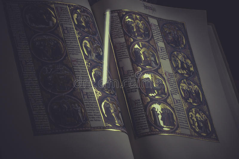 Incunable book handwritten by monks, made in gold stock images
