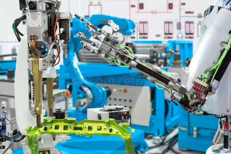 Indústria robótico do robô do controle da mão na fabricação automotivo, conceito futuro da tecnologia imagem de stock royalty free