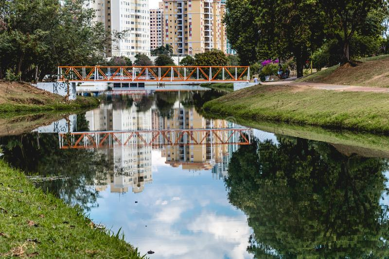 Small orange bridge in the Ecological Park, in Indaiatuba, Brazil. Indaiatuba, Brazil; 2018, july. Small orange brige in the Ecological Park Parque ecologico, in royalty free stock photo