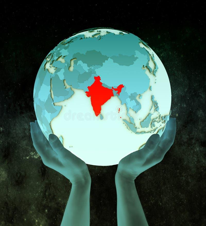 Inde sur le globe bleu dans des mains illustration de vecteur