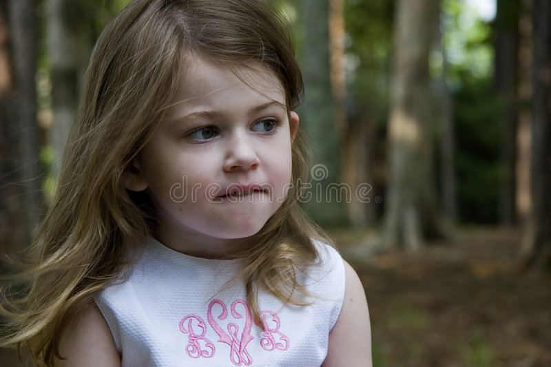 Indecision. Little Girl Biting Her Lower Lip... Thinking royalty free stock photo