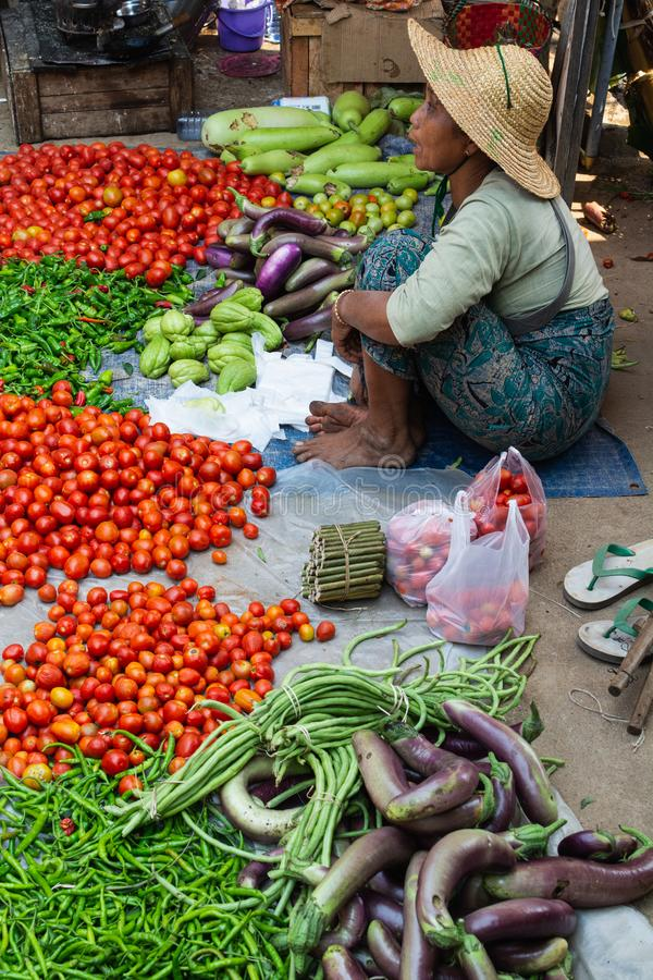 Indein, Myanmar - March 2019: Burmese woman sells vegetables on the street market stock images