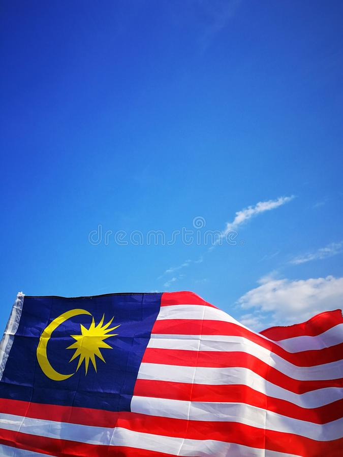 Independece day & merdeka concept. Blue sky and copy space. 16september, malaysia royalty free stock photography