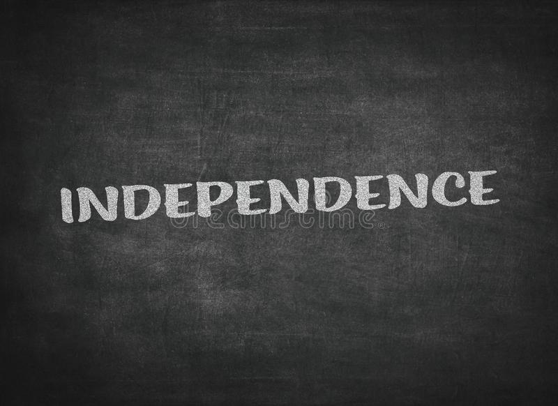 independence concept word on a blackboard background stock photos