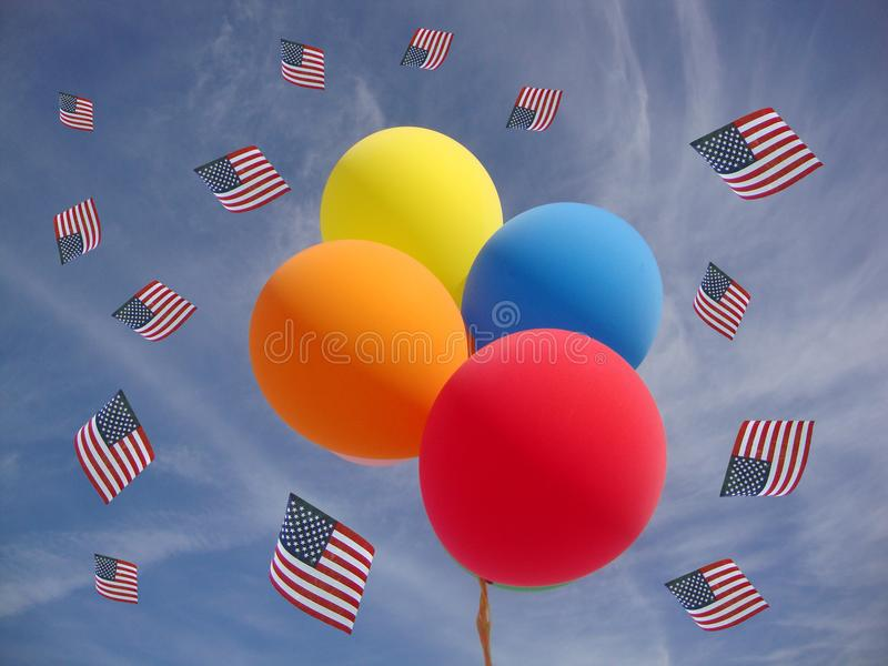 Independence Day Balloons against blue sky with US flags royalty free stock photography
