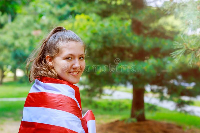 Independence Day Beautiful young girl covered with US flag.  royalty free stock image