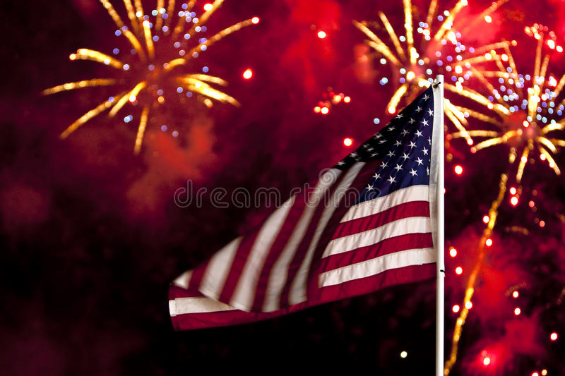 Independence Day Fireworks. With the US Flag in the foreground stock photos