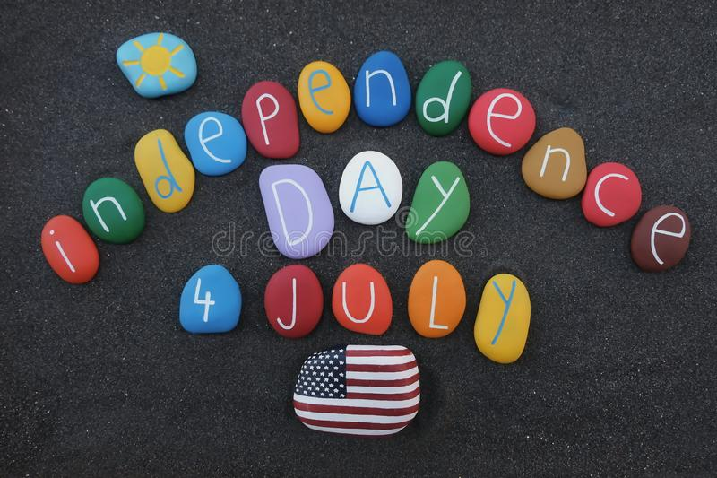 4th July, Independence day with colored stones over black volcanic sand royalty free stock photo
