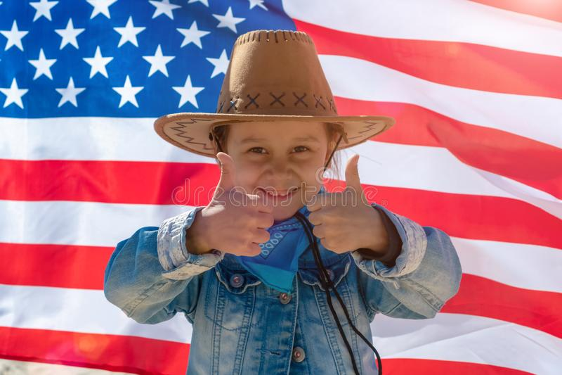 Independence Day. Patriotic holiday. Happy kid, cute little child girl with American flag. Happy kid thumbs up, cute little child stock photography