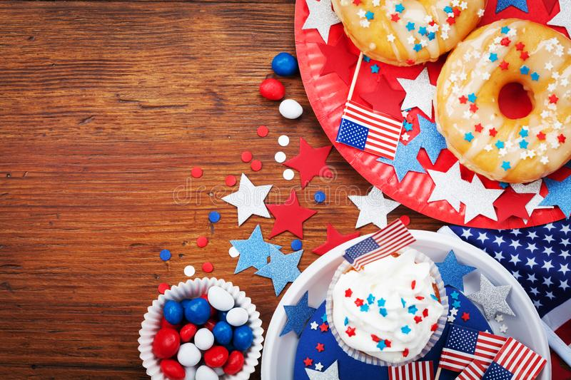 Independence Day 4th july background with american flag decorated of sweet foods, stars and confetti. Holidays table top view. royalty free stock photo