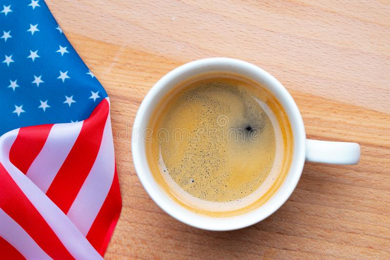 Independence Day USA concept. Memorial Day. Cup of coffee with American flag on white background top view. Flat lay stock photography