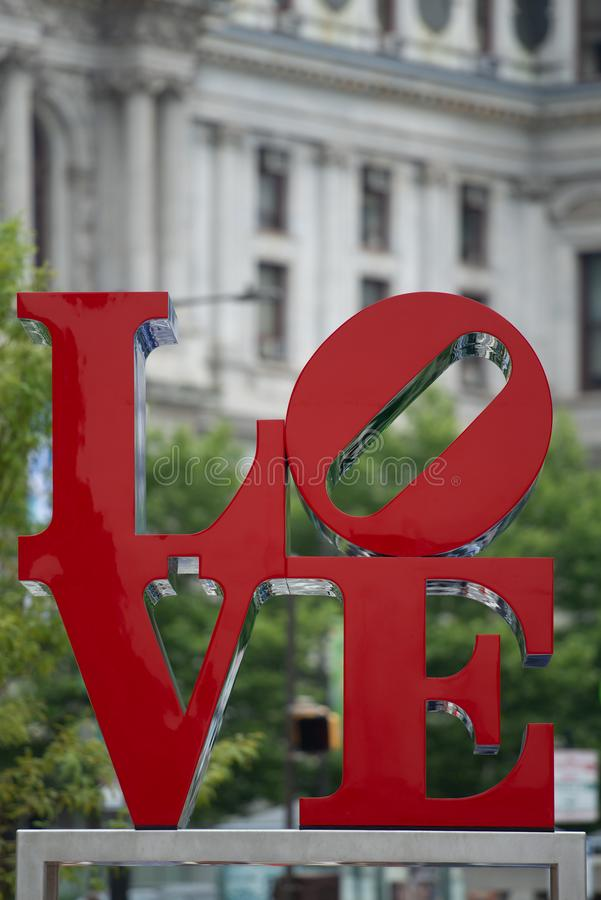 Independence hall and the love statue. Philadelphia love statue with Philadelphias independence hall in the background royalty free stock images