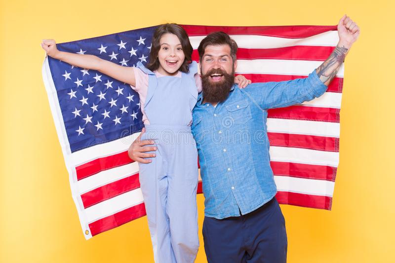 Independence is happiness. How do americans celebrate independence day. Father bearded hipster and cute little daughter. With USA flag. Patriotic family royalty free stock image
