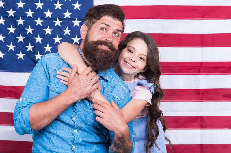 Independence is happiness. Independence day holiday. Father american bearded hipster and cute little daughter with USA. Flag. Freedom fundamental right. How do royalty free stock image