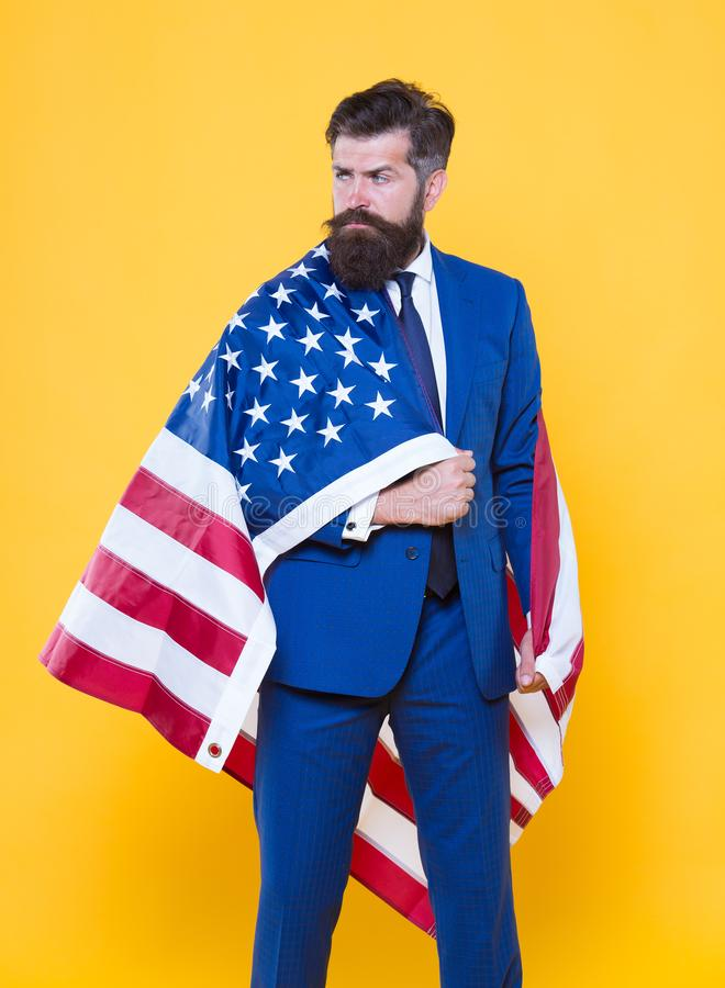 Independence means decide according to law and facts. Businessman bearded man in formal suit hold flag USA. Businessman royalty free stock photos