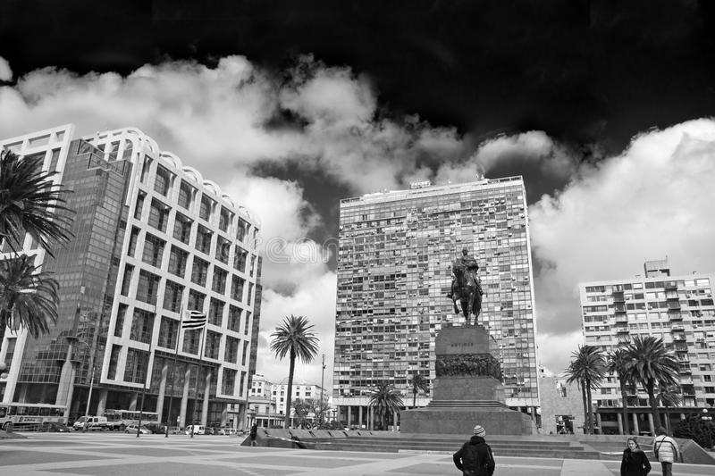 Independence Square. Monochrome photo. Independence Square, the main square in Montevideo. In front, the equestrian statue of Jose Gervasio Artigas. Behind the stock photo
