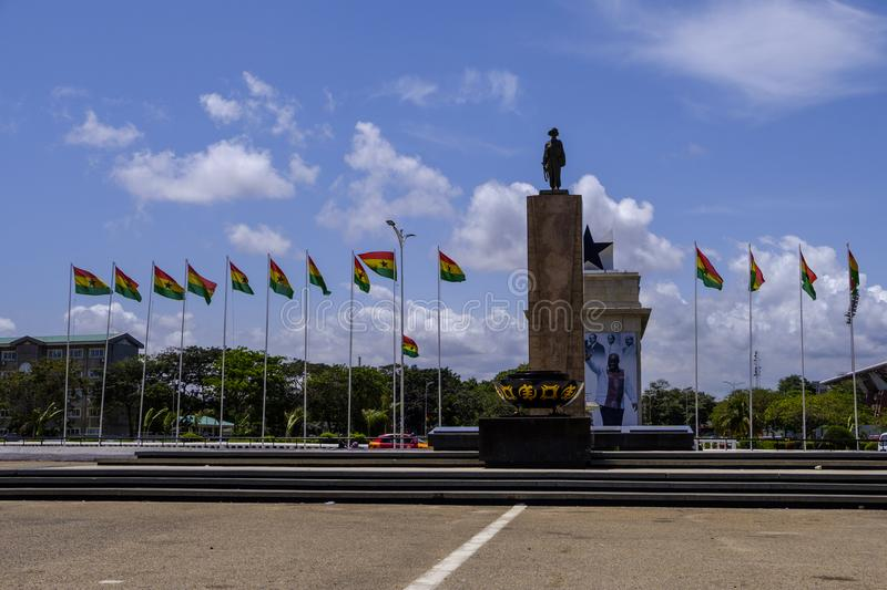 Independence Square statue Accra Ghana. ACCRA,GHANA - APRIL 11 2018: Statue of soldier and flags of Ghana in Accra`s Independence Square, venue for Independence royalty free stock image