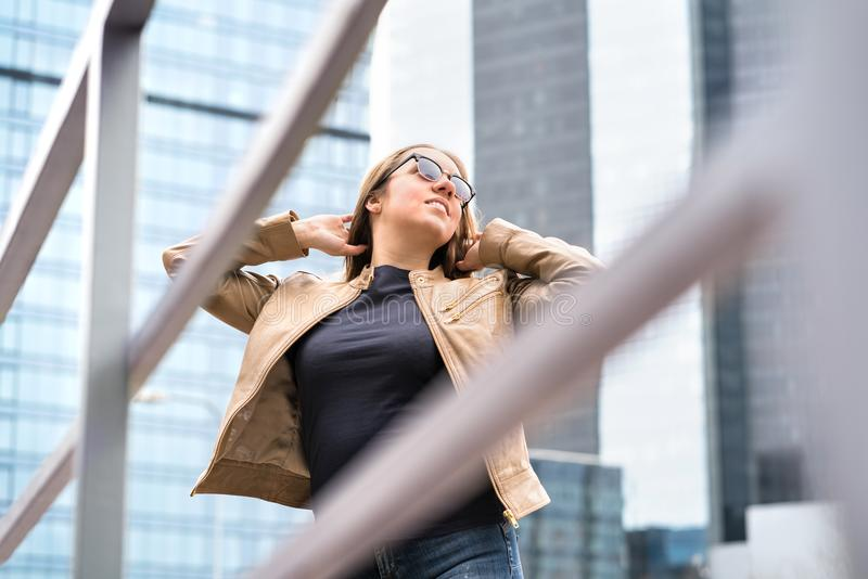 Independent, confident and powerful woman in city. stock photography